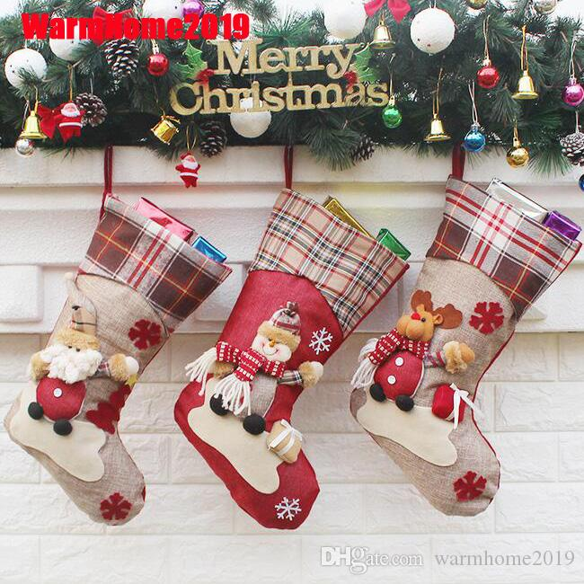 Los titulares de Navidad Medias de Santa Claus muñeco de nieve del calcetín caramelo bolsa de regalo de navidad ornamento de navidad Decoración para el hogar
