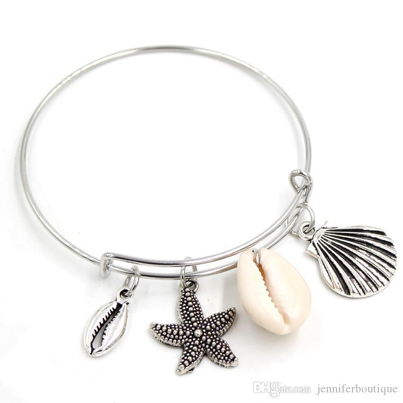 Оптовая Новое прибытие Браслеты шарма Привязать ювелирных изделий Cowrie Shell браслет Seashell браслет моря оболочки ювелирные подарки для женщин девочек