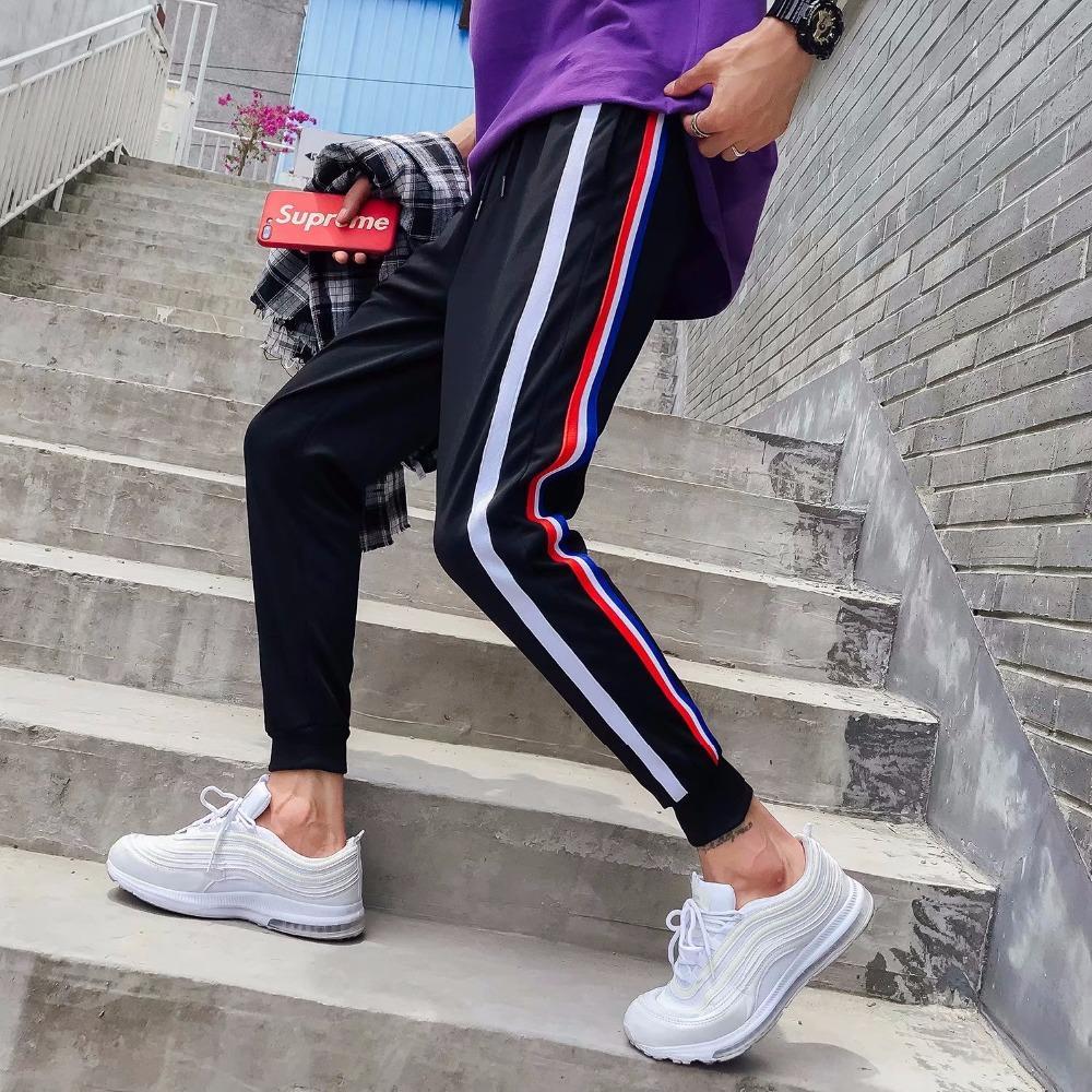 2018 manera ocasional flojo de la raya de impresión de algodón pantalones de hombre elástico de la cintura Harem Hip Hop tamaño Pantalones Joggers pantalón