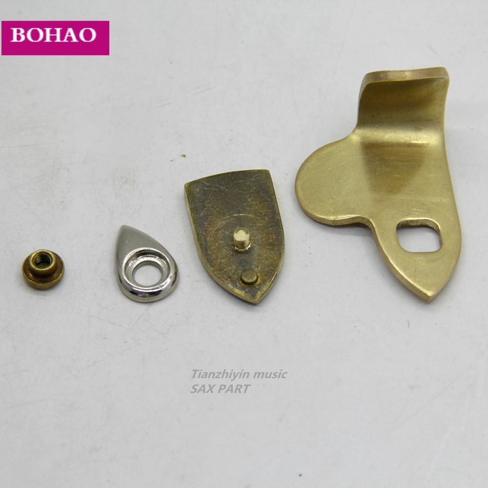Nuovo sassofono Sax Thumb Riposo Hook Alto sax riparare le parti in ottone verniciato + pad Finger attesa del sassofono Sax Thumb Riposo Hook 1pcs