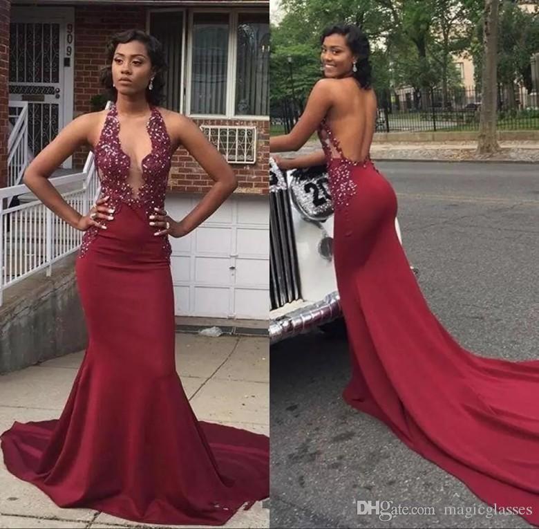 Sexy Halter sirena africana vestidos de baile 2019 Rebordear Backless Tren largo Chicas negras Ropa de noche formal Vestidos de fiesta burdeos Vestidos