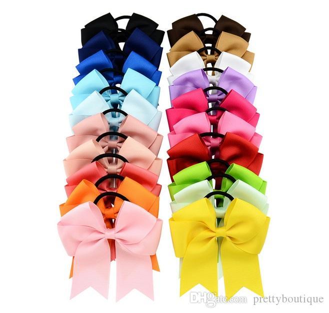 20 couleurs bowknot filles solides Cheerleading cheveux Bow ruban gros-grain Cheer Bow bande élastique pour cheveux Porte-queue de cheval fille / femmes A172