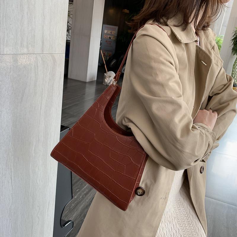 Net Red Pequeña bolsa 2020 nuevo nicho Diseño shi tou wen axilas Bolsa de hombro otoño minimalista Por Vintage
