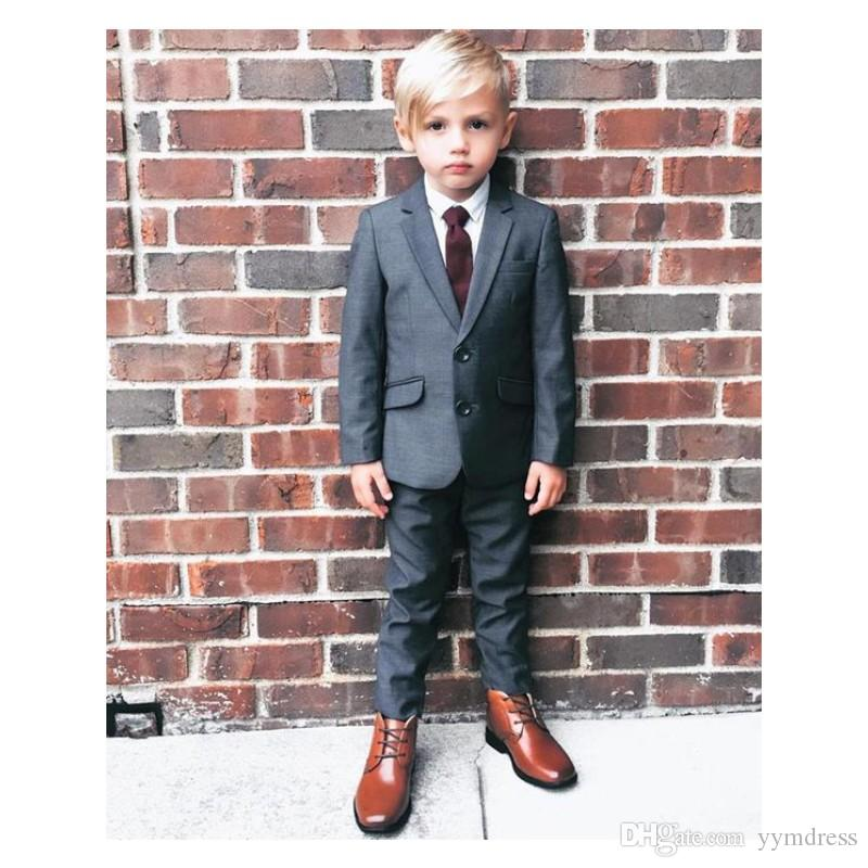 2019 Black Boy Wedding Tuxedos Notched Lapel Two Buttons Boys suits Slim Fit Ring Bearer Suits (Jacket+Pants+Tie)