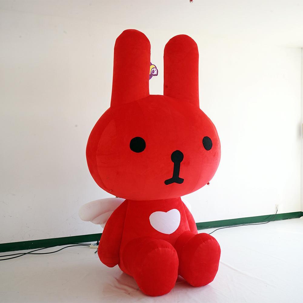 Exhibitiona mostrar juguetes de peluche de conejo rojo preciosas inflables Pascua decorativo inflable ángel conejo de dibujos animados conejo rojo personalizado