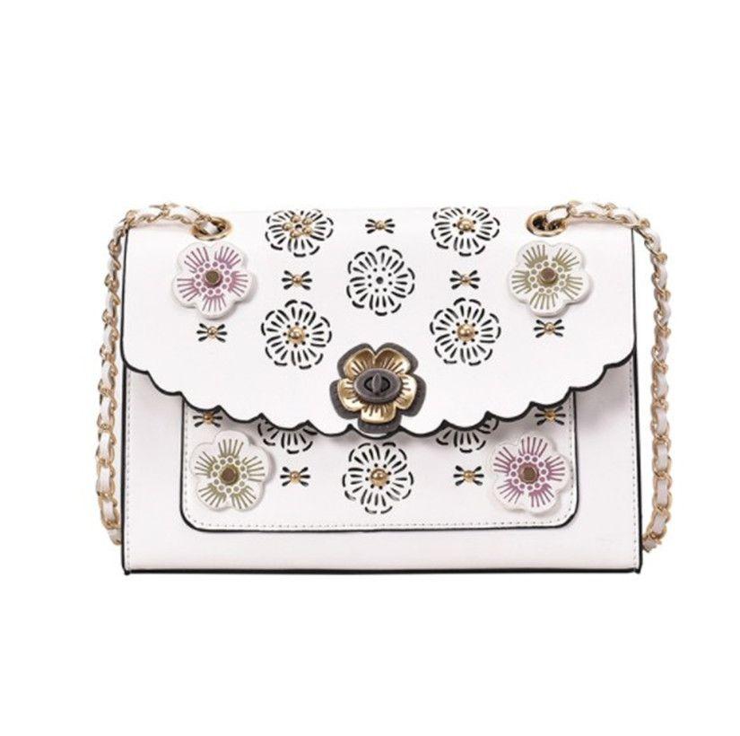 Luxury Designer Sac à bandoulière Sac à main Besaces Sac à main Nouveau mode sac avec toutes sortes de chaînes une épaule creuse Fleur