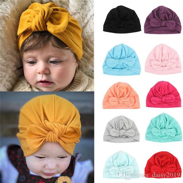 Nuevo sombrero del bebé lindo de los oídos de conejo anudadas Modelo algodón Cap sombrero para 13colors bebé niña y un niño