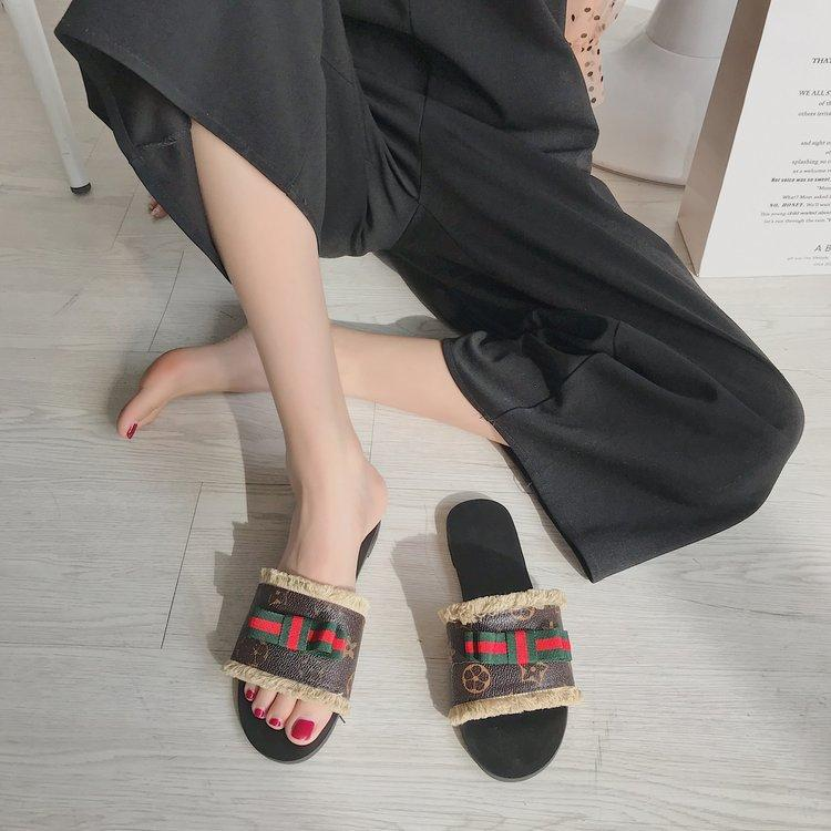 modelos de moda de ocio Joker ocio zapatillas planas palabra arrastrar el hogar salvaje verano zapatos de desgaste exterior fábrica europea y americana del enchufe