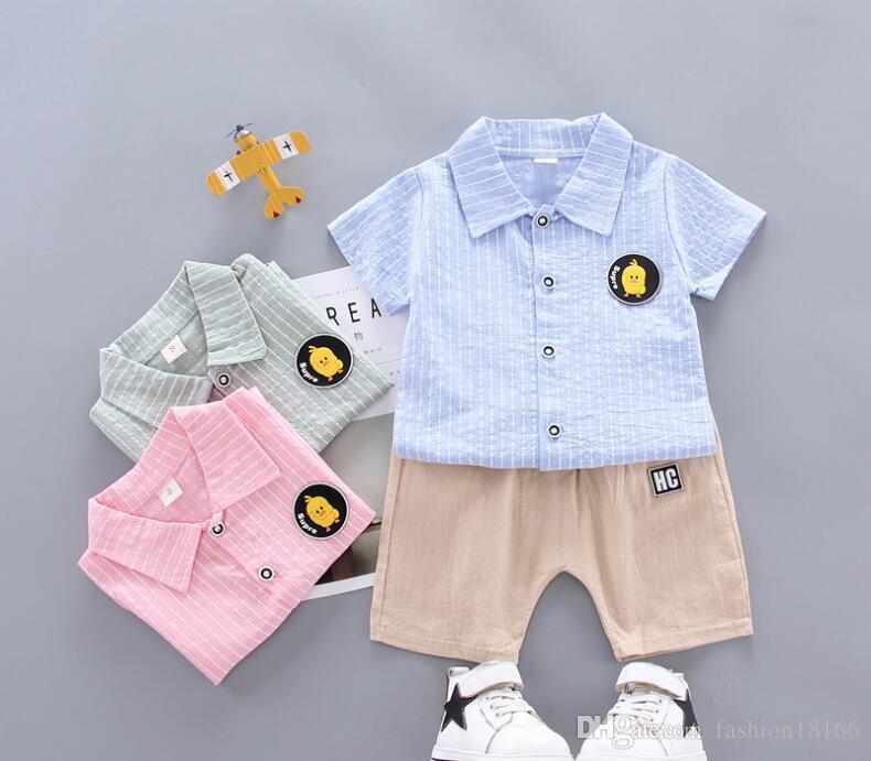 새로운 2020 여름 캐주얼 버전 아기 아동 정장 의류 사년 자식 핀스트라이프 옷깃 작은 노란색 오리 셔츠 짧은 소매