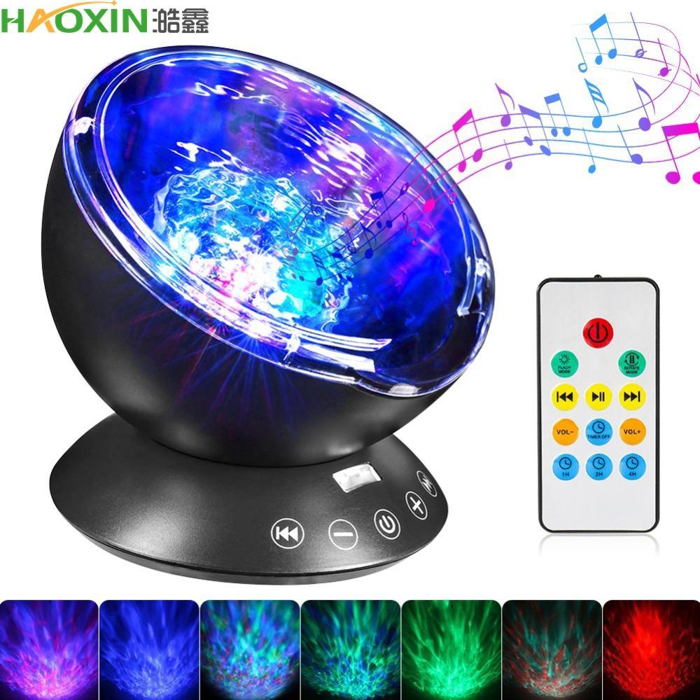 Haoxin Dropshipping 7 colori LED Night Light Sky remoto Oceano di controllo del proiettore dell'onda con la lampada del bambino Mini musica della novità o bambini