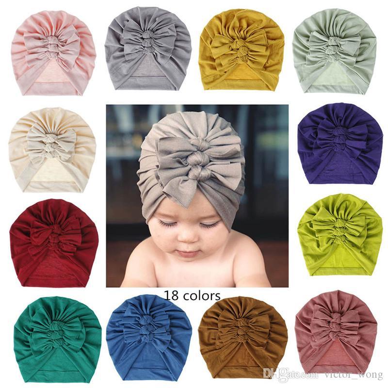Faccone per neonati Solid 18 Colori Archi BOWS Bambino indiano Turban Neonato Cappellini Berretto Berretto Bambino Capelli Accessori per capelli