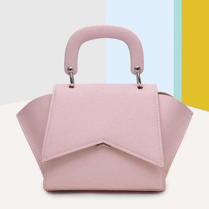 Самая горячая марка дамы модные сумки высокого качества дизайнер сплошной цвет замок крылья крылатый сумка пригородных дамы бесплатная доставка