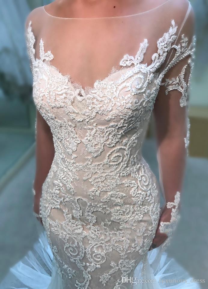 Nouvelle Illusion manches longues en dentelle sirène robes de mariée Tulle Applique Cour de mariage Robes de mariée avec boutons plage taille plus jeune mariée