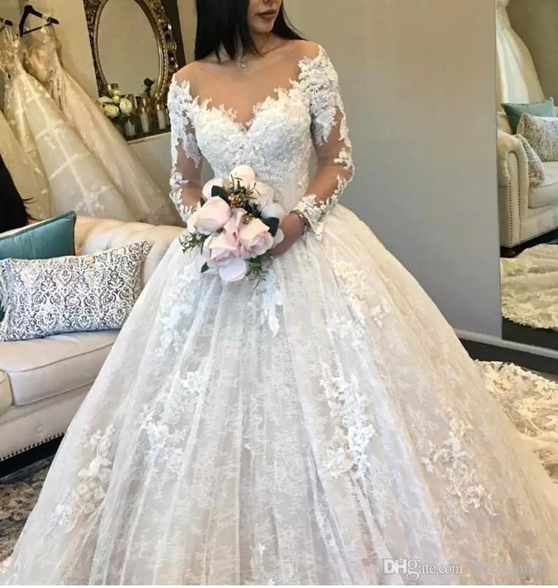 2019 Designer Ball Gown Wedding Dresses Long Sleeves Sheer Neck Tulle Appliques Fitted Puffy Lace Bridal Gowns Alibaba Robes De Mariee Ball Wedding Gown Ballroom Gown Wedding Dresses From Freedomlife 155 48 Dhgate Com