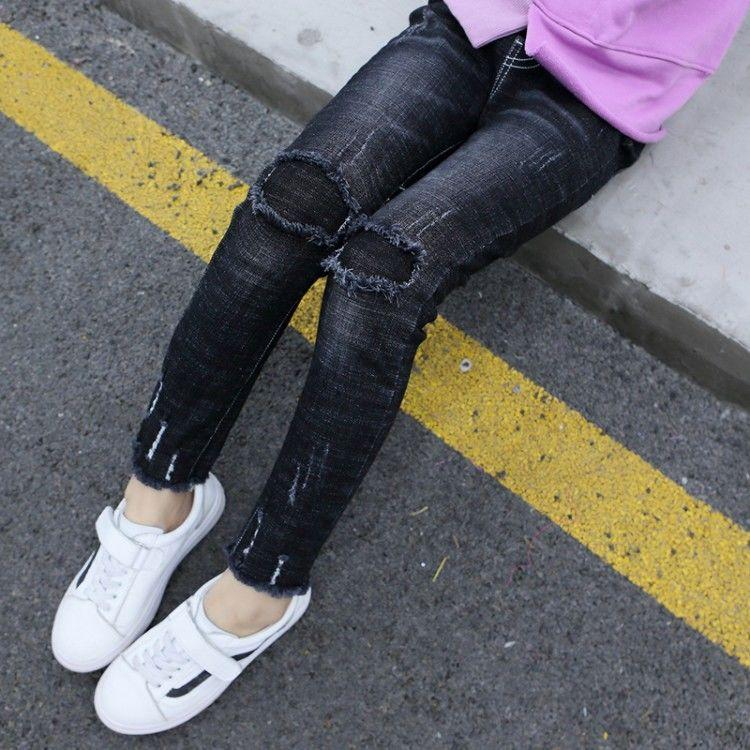 2020 El nuevo resorte niños del otoño muchachas ocasionales de los pantalones vaqueros rasgados elástico fina delgada del dril de niños grandes jeans muchacha ropa de los niños T77