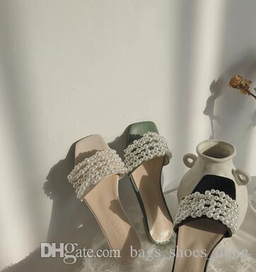 Yaz aylarında yeni moda kadın dış inci tatil düz dipli açık parmaklı plaj sandalet