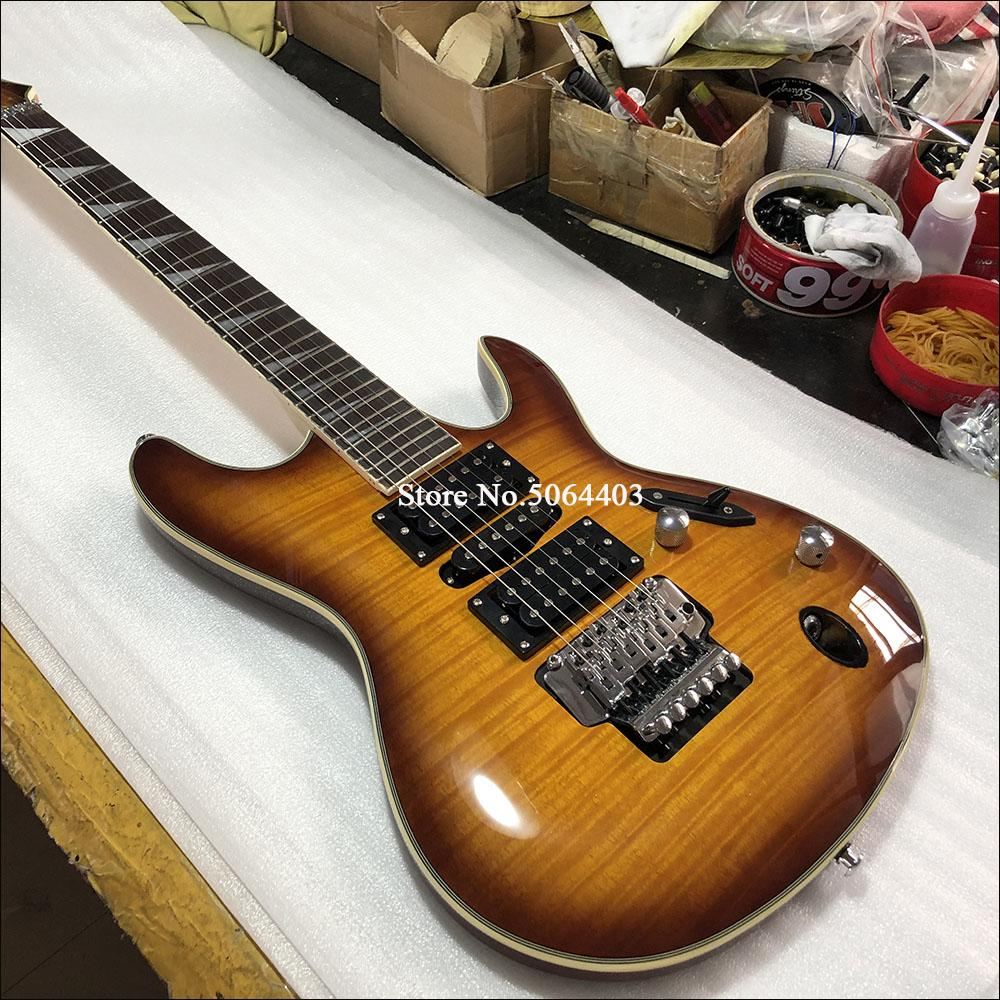 High quality 6-string electric guitar, yellow tiger veneer, rose wood fingerboard, double rocking bridge, silver fittings