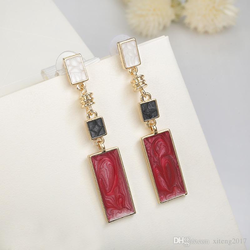 Nuova moda semplice Jewelry Design geometrica orecchini per le donne Ragazze Red Stone ciondola Orecchini coreana di modo di stile