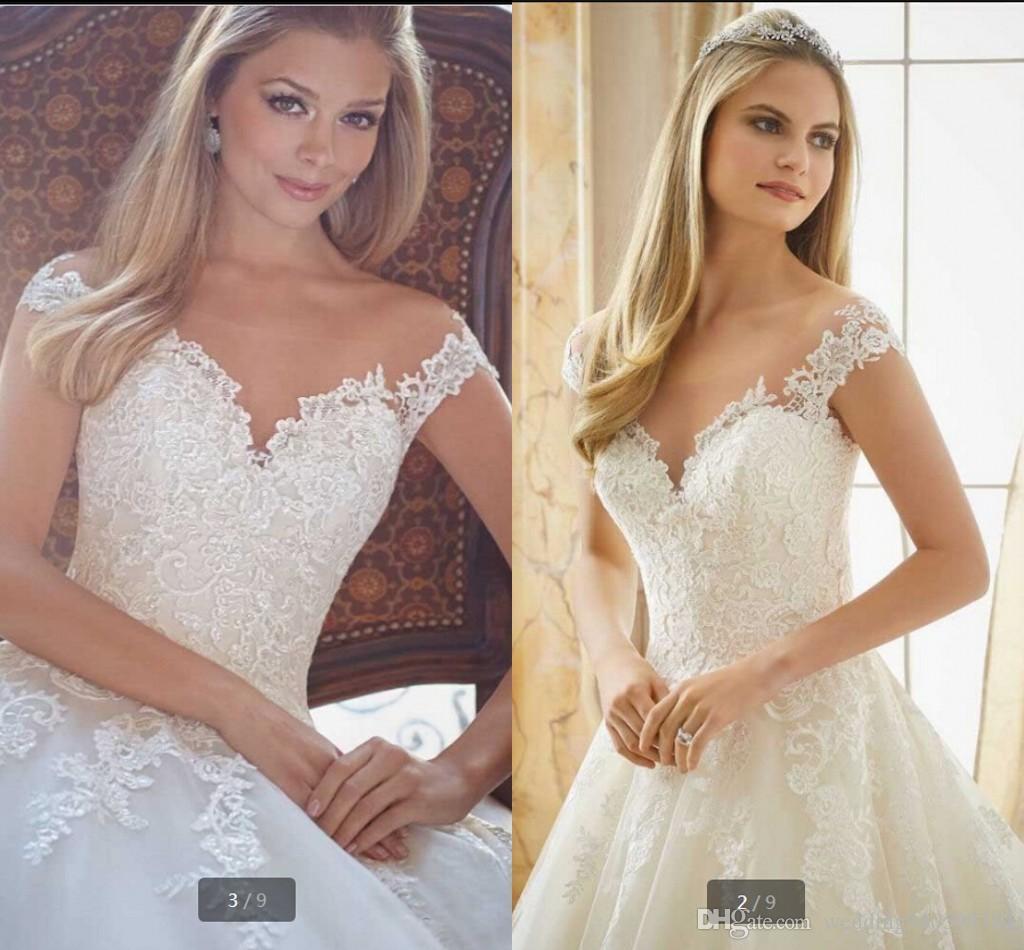 Última bola caliente Venta vestido largo sin espalda de encaje vestidos de novia manga del casquillo apliques de perlas botón Atrás Vestidos de vestidos de novia