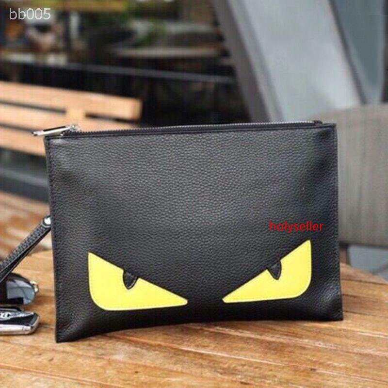 2020 clássico Pequeno Monstro Clutch Bag Pequeno Diabo Bolsa Envelope Tide masculino novo Leather Clutch Bag Factory Direct Sale Tamanho 28x20x2cm