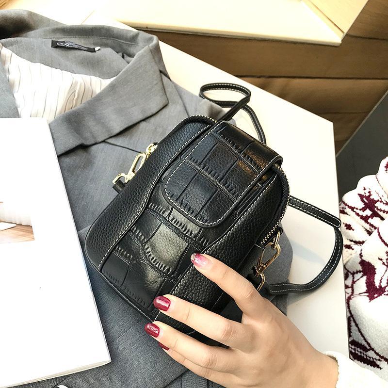 Nouveau Sac à bandoulière en cuir de vache femmes véritable Messenger Bag en cuir bandoulière Femme Mode d'embrayage Sacs à main téléphone simple