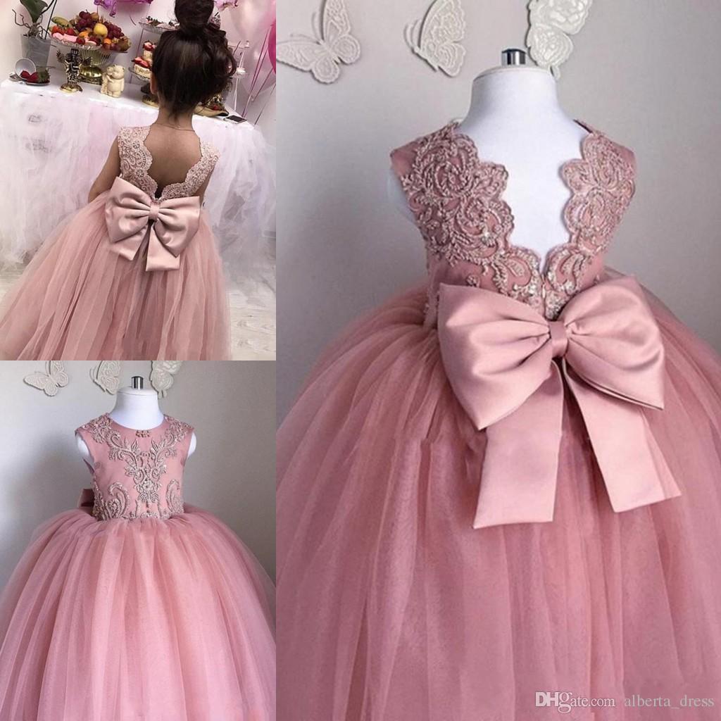 2019 Pink Flower Girls Dresses Sheer Jewel Neck sin mangas apliques de encaje Tulle Girl Vestidos del desfile Vestidos de princesa de cumpleaños con lazo grande