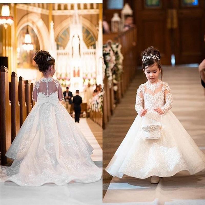 2020 Lovely Flower Girls Vestidos para bodas Princess Jewel Mangas largas Apliques de encaje Big Bow Sweep Train Little Kids Holy Pageant Dress