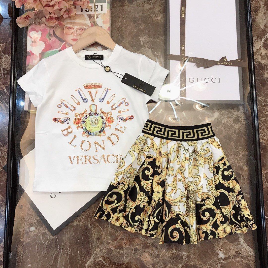 Las niñas de algodón superior camiseta clásica falda plisada suave cómodo y transpirable, delicado sistema de dos piezas 031412