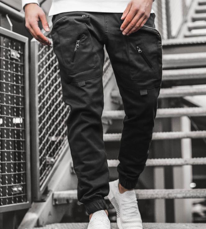 Los pantalones multibolsillos tejida para hombre de la cremallera de carga Hombres de bolsillo de la ropa del diseñador de moda informal sueltas macho pantalones