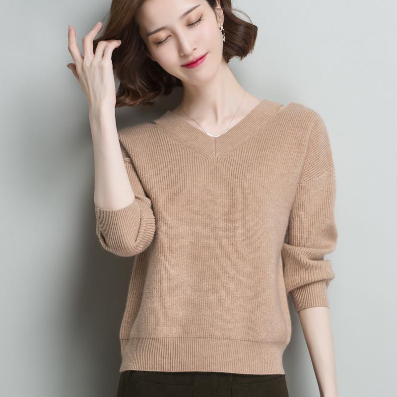 Neue Winter-Strickjacke-Frauen-koreanische Version der lose Knit V-Ausschnitt warme lange Hülsen-Strickjacke Art und Weise beiläufigen