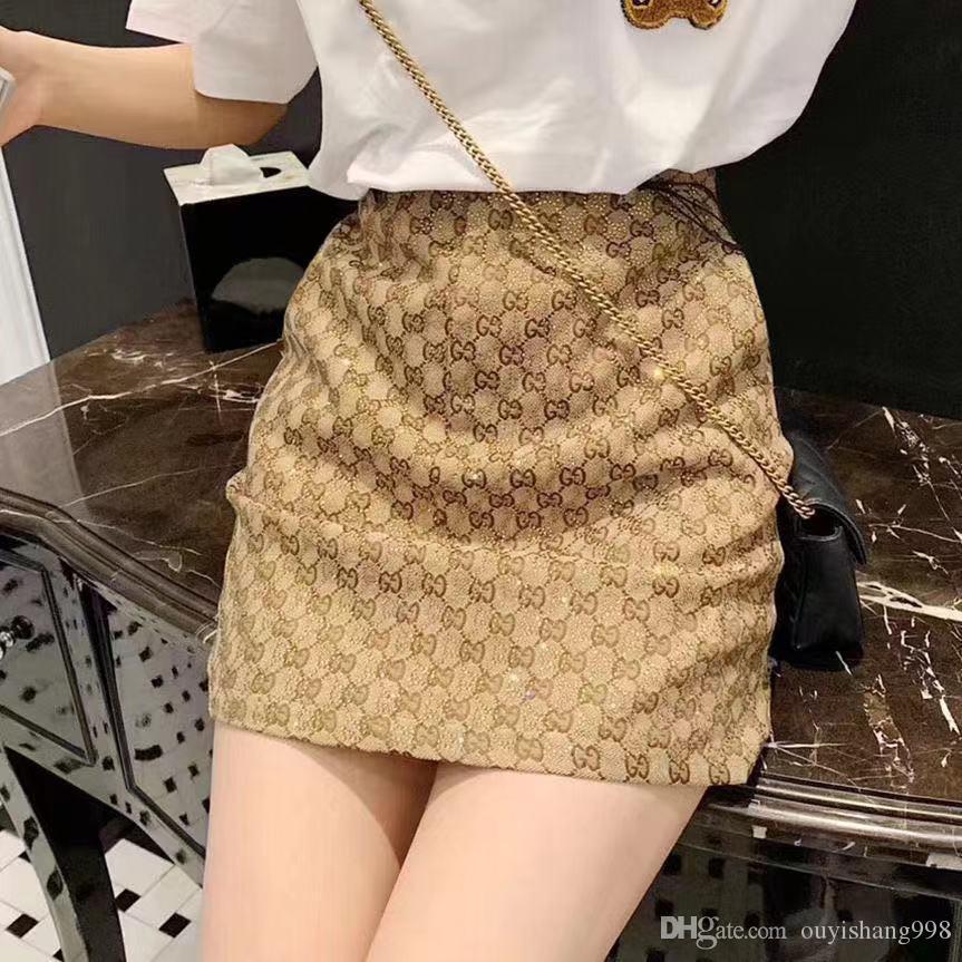 El diseño de alta calidad de talle alto una línea de dama falda 2019 verano y otoño del todo-echó a un lado de planchado y perforar falda corta delgada para mostrar