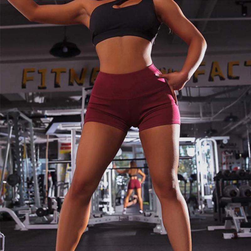 Glutei Pantaloncini fitness alte donne della vita sportiva traspirante ad asciugatura rapida per il tempo libero elastico che eseguono esercizi di yoga 3 indica i pantaloni