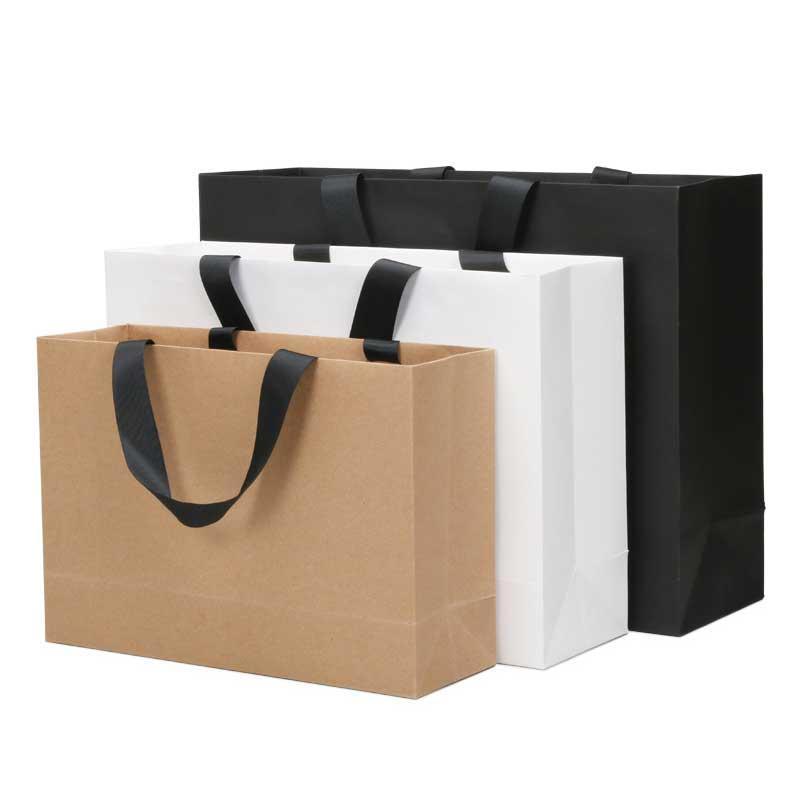 كرافت ورقة بيضاء بطاقة 250G والملابس التسوق هدية الزفاف المحمولة كيس ورقي 27x38 22x32 17x25cm LOGO للتخصيص