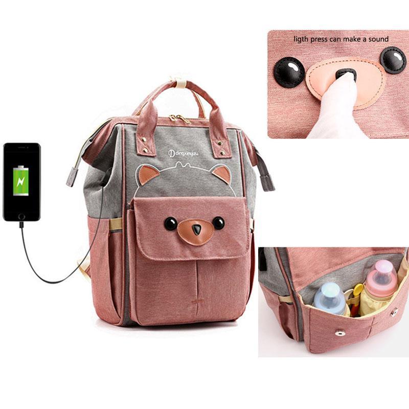 2019 nuevo pañal impermeable del bolso de USB para mamá maternidad pañal Mochila cochecito de bebé Organizador de enfermería Bolso cambiador de Cuidado