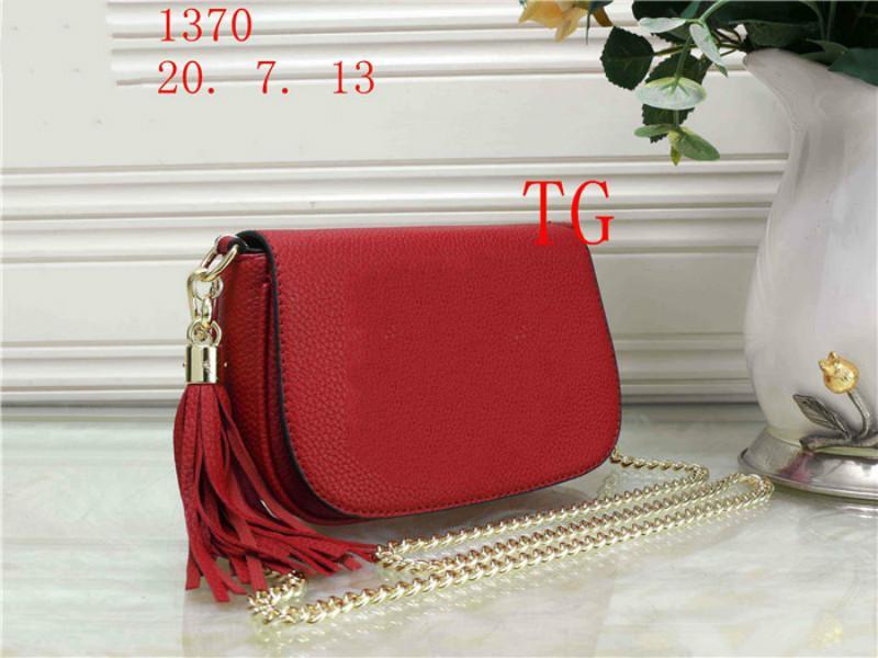 Famosa modo di alta qualità del progettista del cuoio sacchetto dell'unità di elaborazione del corpo Croce colore puro femminile Donne spalla della borsa con frange borsa borsa