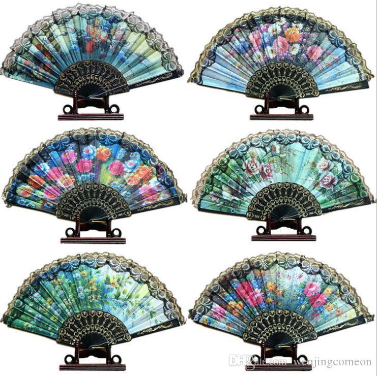 Nuovo stile cinese in pizzo ventaglio pieghevole tenuto a mano dance party wedding decor pieghevole tenuto in mano ventaglio di stoffa osso di plastica