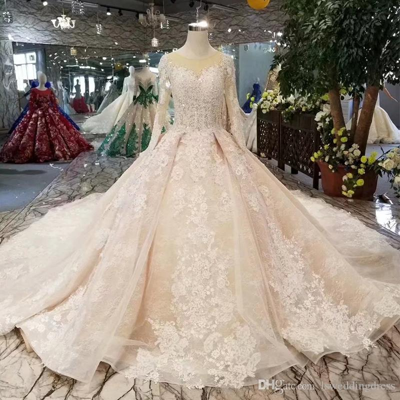 Luxury Applique Ball Gown Wedding Dress Light Champagne Illusion O-Neck Long Sleeves Lace Up Back Beaded Wedding Gown With Royal Train