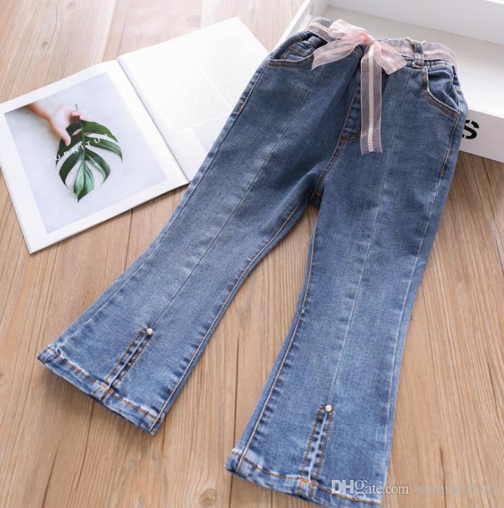 Fashion kids jeans 2019 Autumn girls ribbon lace-up Bows belt denim pants children double pocket pearls spit casual cowboy trouser F8531