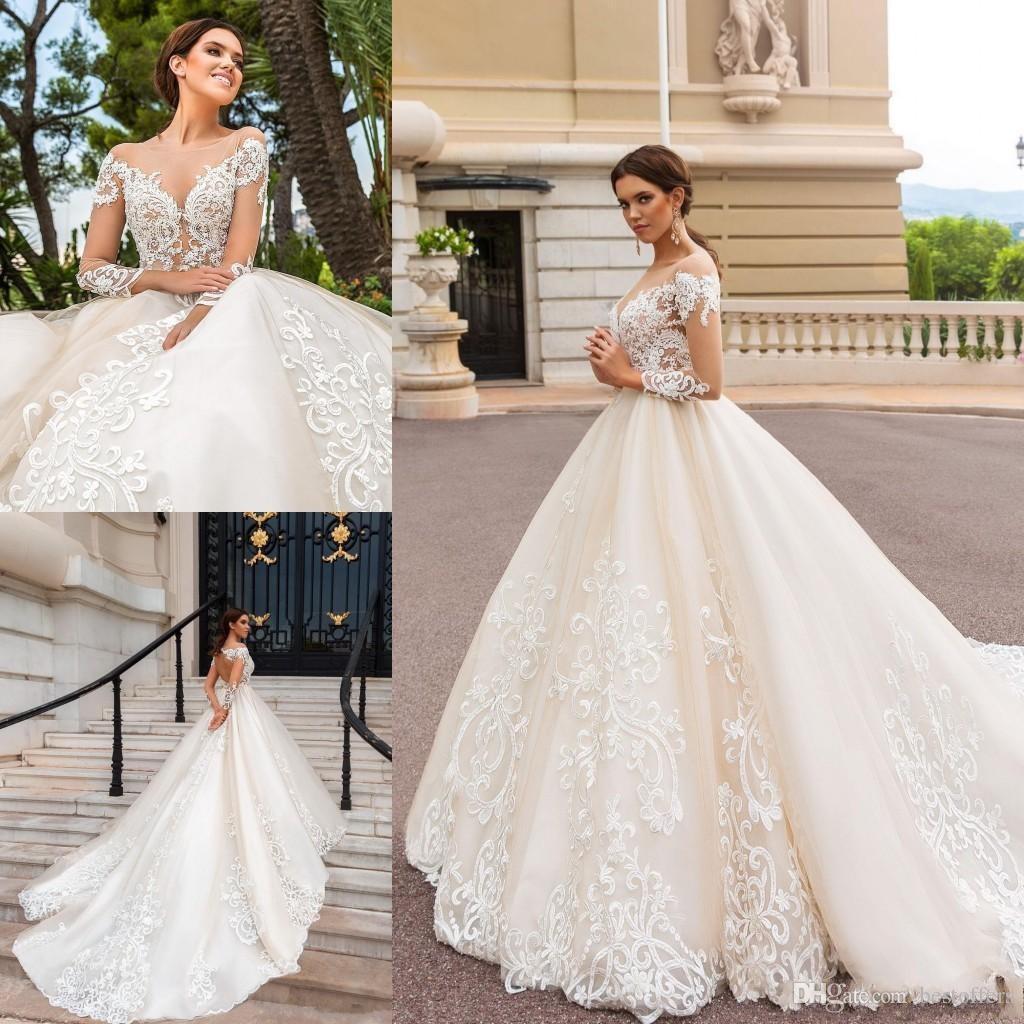 2019 Vintage Långärmade Champagne En linje Bröllopsklänningar Sheer Neckline Lace Appliques Bridal Gown Court Train BA5462