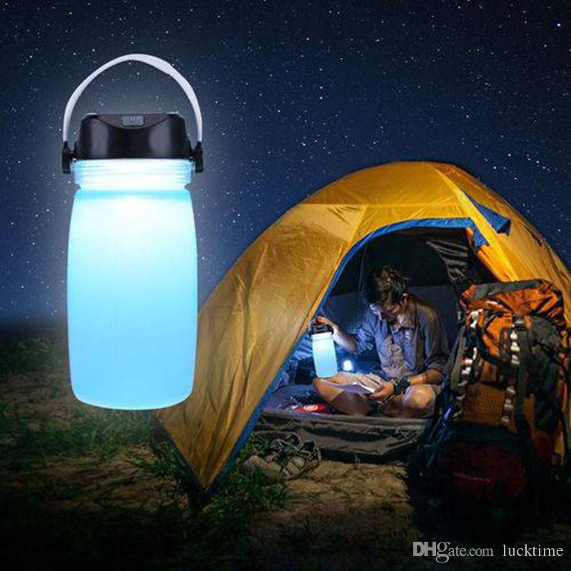 Botella de agua de múltiples funciones al aire libre lámpara de grado alimenticio de silicona Drinkware impermeable luz plegable USB recargable solar botella de luz LED