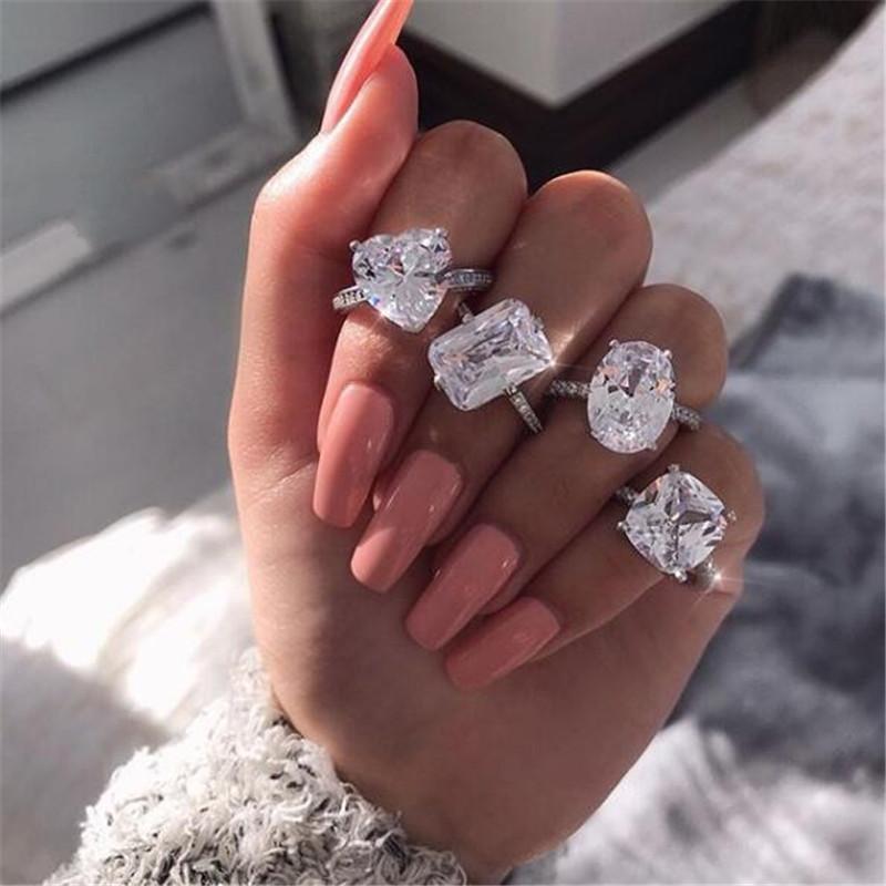 Talla 5-10 INS Top Venta Sweet Cut Simple Fashion Jewelry 925 Sterling Silver Pear Cut Blanco Topaz CZ Diamond Eternity Women Anillo de boda