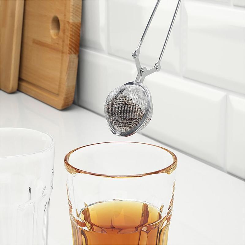 1pcs creativo cucchiaio in acciaio inox palla da tè filtro a base di erbe infusore filtro spremere cucchiaio in acciaio inox manico cucchiaio