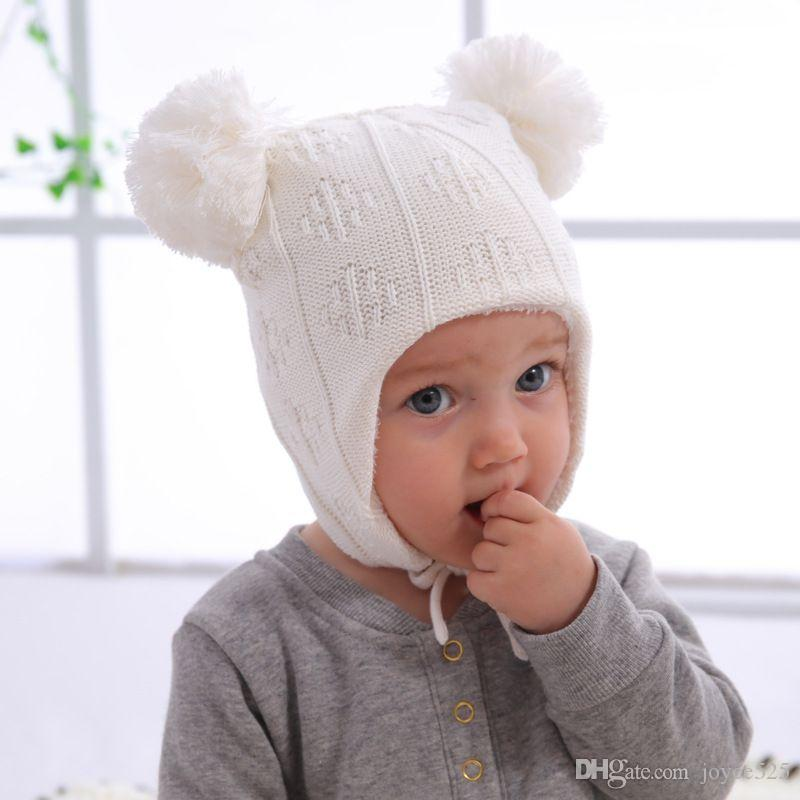 New Baby hat baby winter girl boy new plus velvet Hair ball baby knit earmuffs cold warm wool cap for kids 1-2Y