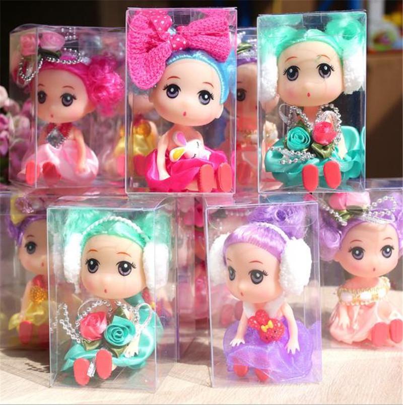 Venta caliente 6 muñeca de dibujos animados bebé juguete niña dibujos animados cabeza grande muñeca móvil conjunta