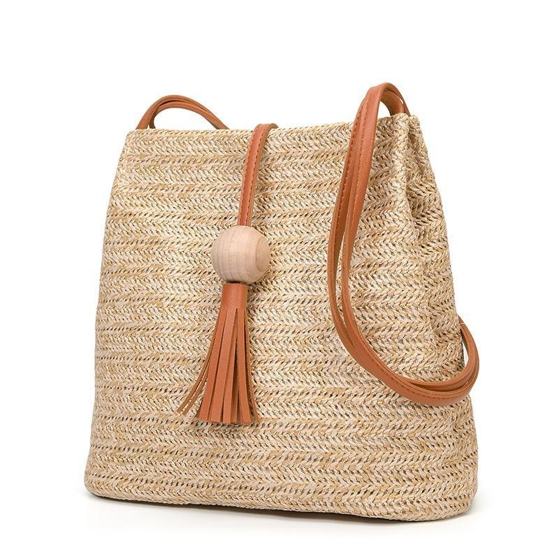 Nouveau style simple et polyvalent style Seau Sac seule épaule bottes de paille Sac en bois balle Fringe sac à bandoulière pour les femmes