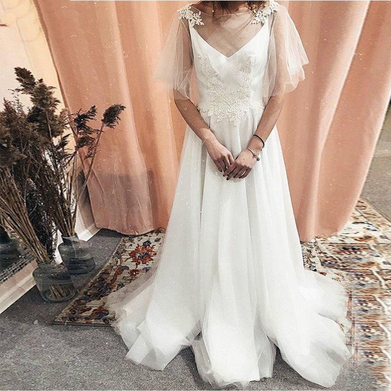 Romantico Una linea Boho Abiti da sposa maniche corte in pizzo Beach Abiti da sposa pannello esterno di Tulle Backless Sweep abito da sposa Tain