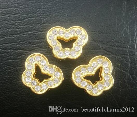 50 unids / lote 8mm oro color de la mariposa encanto de la diapositiva DIY accesorios aptos para 8 MM tiras de teléfono pulsera pulsera jewelrys fashion