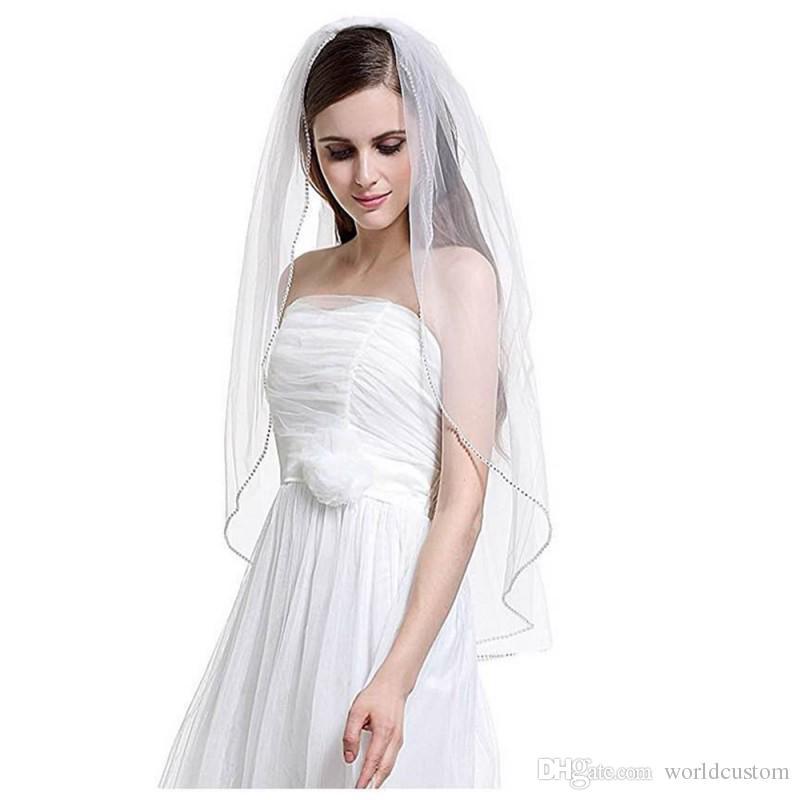 Nouvelle image réelle luxe meilleure vente une couche strass bord voile de mariée avec peigne en alliage voiles de mariée personnalisé blanc longueur des doigts