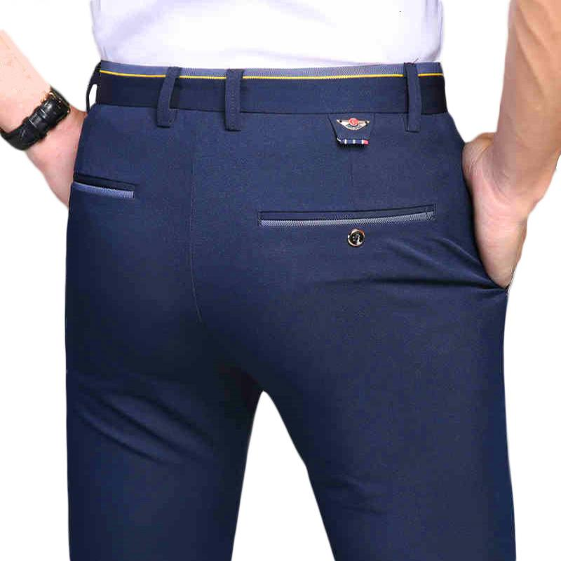 HCXY 2019 nuevos pantalones de los hombres del otoño del resorte Comercio moda pantalones casuales hombres pantalones rectos del juego de negocio de la marca Hombres tamaño de las bragas 38 CJ191201