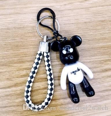 Cartoon ours violent poupée pendentif porte-clés multi-fonction PU cuir tressé noir et blanc corde ornements sac porte-clés